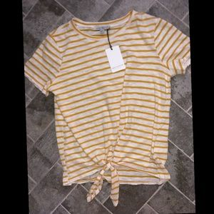 white and yellow striped shirt with knot